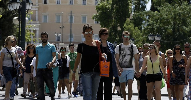 Greek banks reopen but cash limits remain and taxes soar