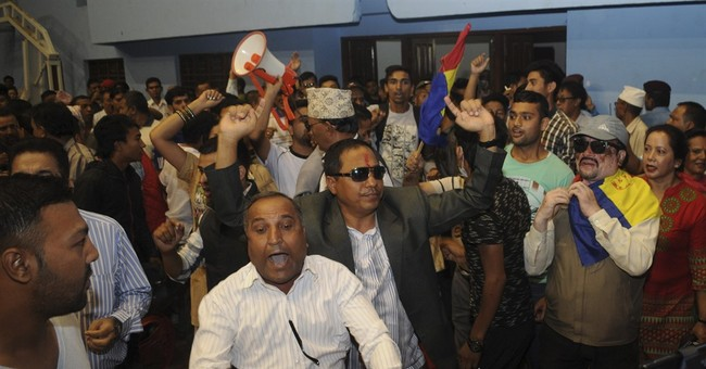 Protesters throw chairs at Nepal's deputy prime minister