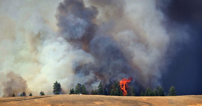 Washington wildfires burn 1 home, threaten dozens of others
