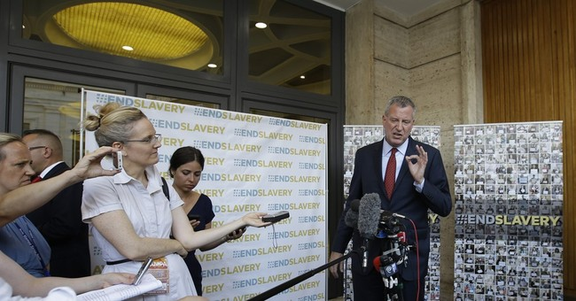 NYC mayor blasts EU on migration, warns Wall St. on climate