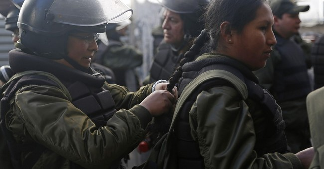 Striking miners clash with police in Bolivia's capital