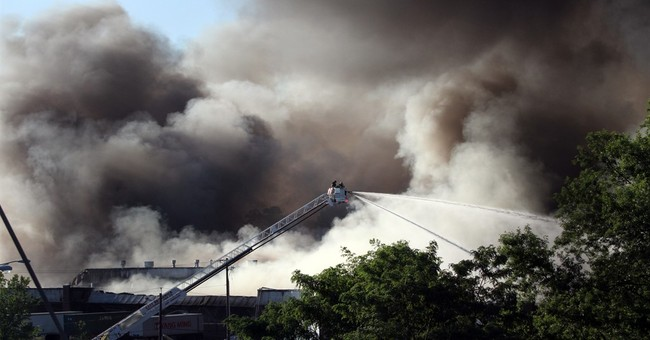 Residents evacuated by huge warehouse fire can return home