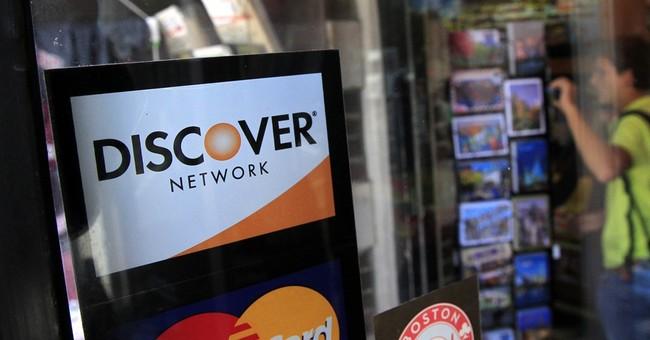 Discover 2Q earnings drop 7 percent; beats forecasts