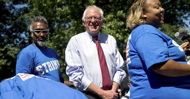 Sanders proposes $15 minimum wage, sets up Clinton contrast