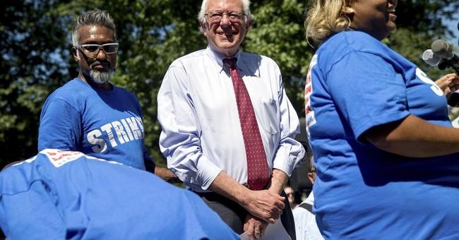 Sanders proposes $15 minimum wage, sets up Clinton contrast