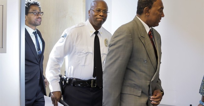 Ferguson hires black police commander as interim chief