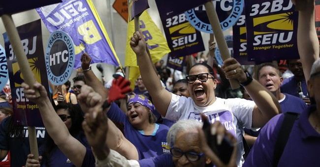 NY board backs $15 minimum wage hike for fast-food workers
