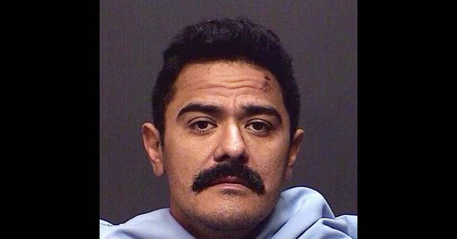 Department clears Arizona officer who hit armed man with car