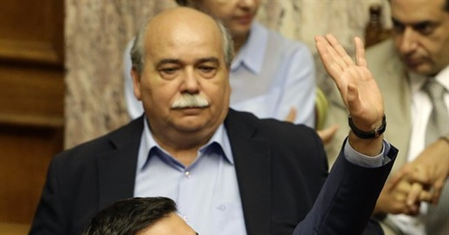 Bailout talks back in Athens, as tough conditions approved