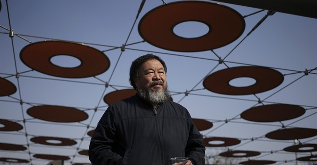 China returns passport to Ai Weiwei, who plans London trip