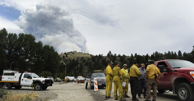 Glacier National Park wildfire forces tourists to leave cars