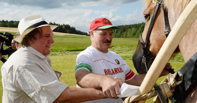 Belarusian president gives Depardieu a lesson in hand-scythe
