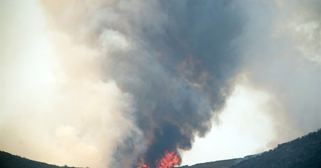 Western wildfires threatening homes and disrupting tourism