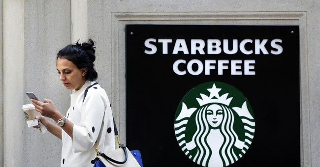 Starbucks profit jumps as customer visits, spending increase