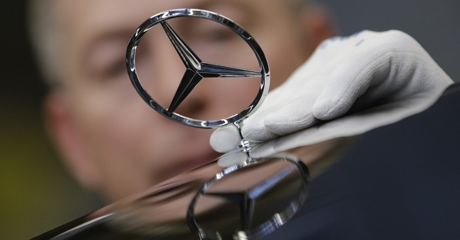 German automaker Daimler posts 8 percent rise in Q2 earnings
