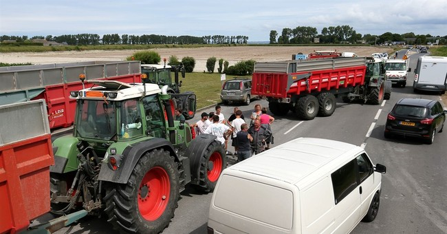 French farmers block Alpine roads over low meat, milk prices