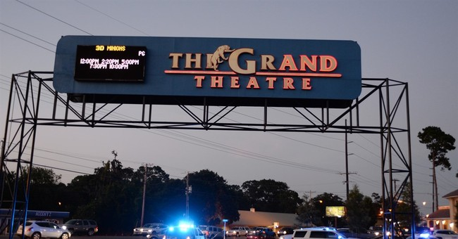 The Latest: Obama briefed on deadly movie theater shooting