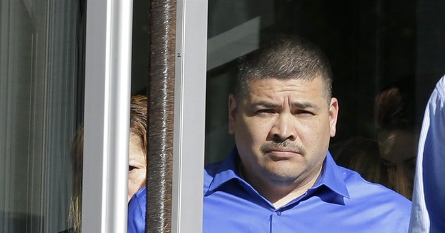 Father of school shooter pleads not guilty to gun charges