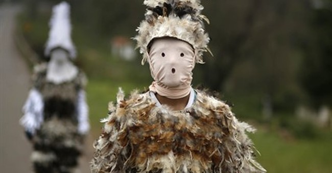 AP PHOTOS: Paraguayans use feathers to pay homage to saint