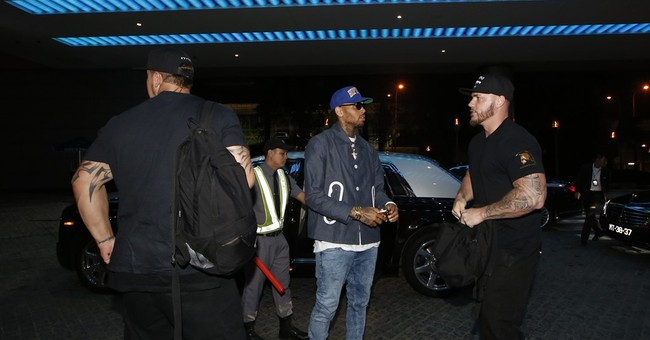Chris Brown leaves Philippines after ordeal over legal issue