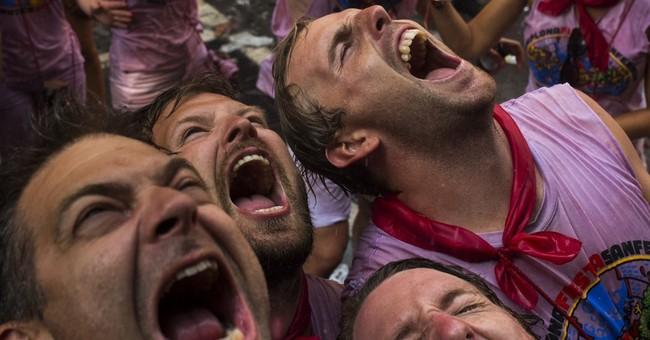 AP PHOTOS: San Fermin, a fiesta of bull runs and revelry