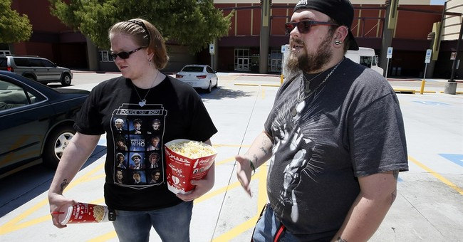 Some moviegoers rattled by shootings, but theaters stay busy