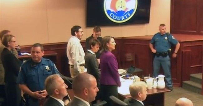 The Latest: Theater shooting juror wore electrocution shirt