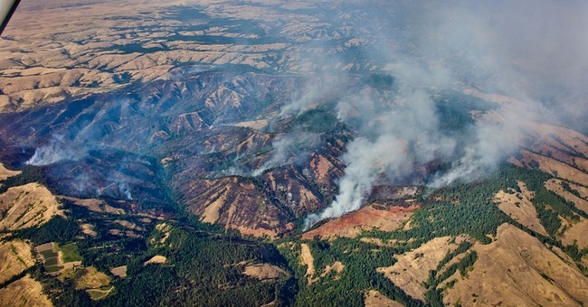 Several wildfires burn in combustible Western states