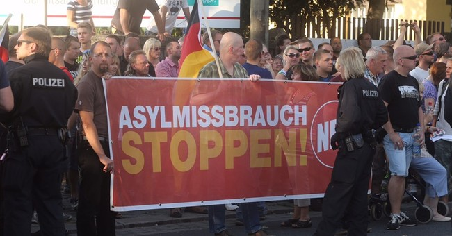 German authorities condemn violence at anti-refugee protest