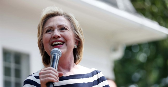 Clinton says she's confident about proper handling of emails