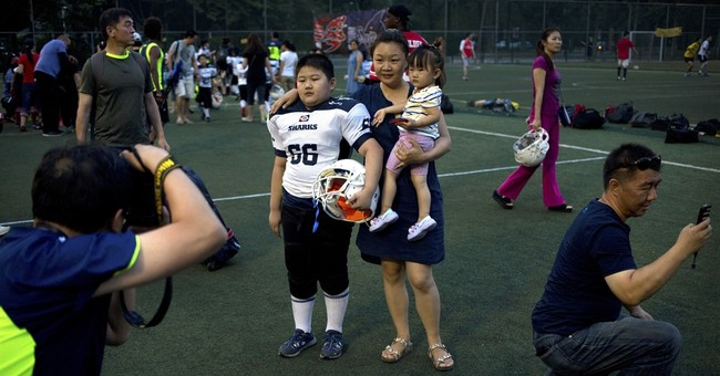 AP PHOTOS: American football gains popularity in China