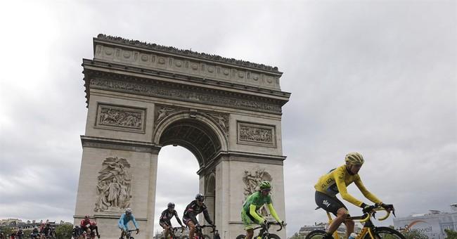 Paris police open fire on car at Tour de France barricades