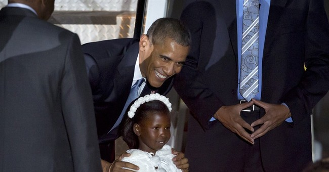 Kenyan girl who gave flowers to Obama goes back to school
