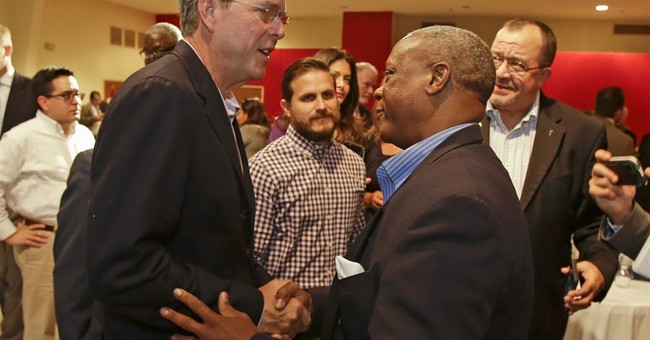 Bush denounces 'crazy message of hate' in campaign