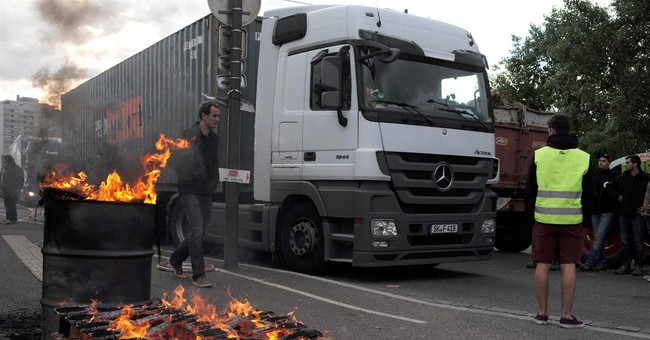 French farmers turn back trucks with foreign meat, cheese