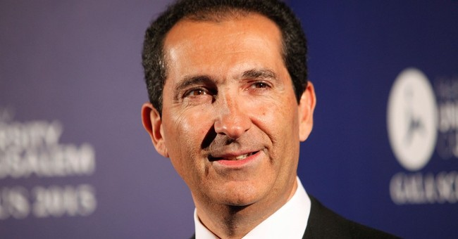 Binge-buying French telecoms mogul teams with media group