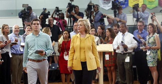 Quiet on Keystone, Clinton faces sharper attacks from rivals