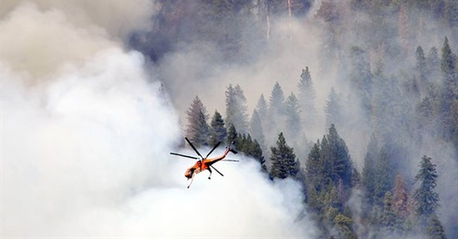 Northern California wildfire jumps line, forces evacuations