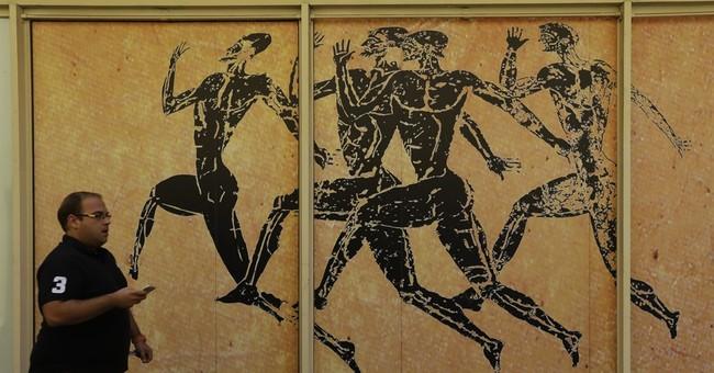 Greece advances in loan talks, under fire for euro exit plan