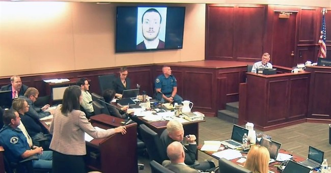 Colorado theater shooter's dad saw wide-eyed smirk before
