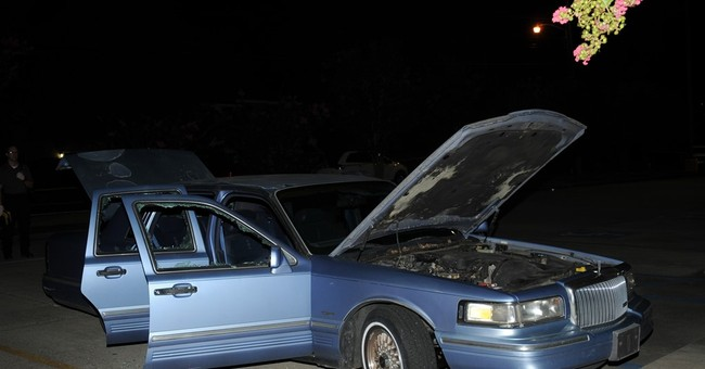 Police release photos of movie theater gunman's car