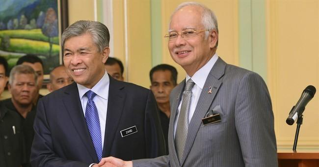 Malaysian PM axes deputy, attorney general amid fund scandal