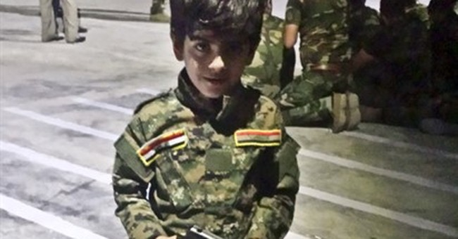 Iraqi militias train young teens to face the threat of IS