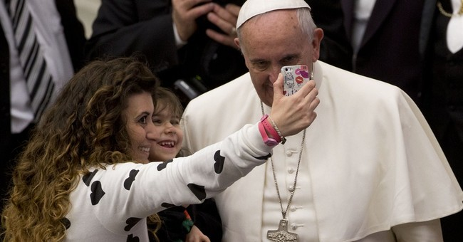 Pope praises big families after 'like rabbits' remark