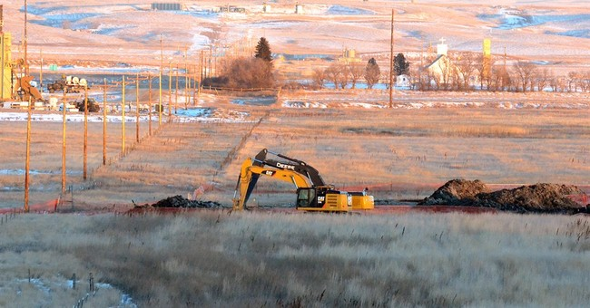 Barriers set up, water tested at site of North Dakota spill
