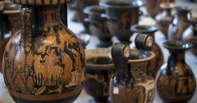 Italy unveils record haul of antiquities from Swiss raids