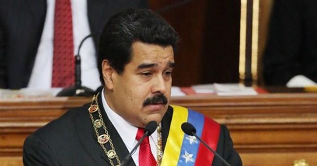 Venezuela leader rejects devaluation amid faltering economy