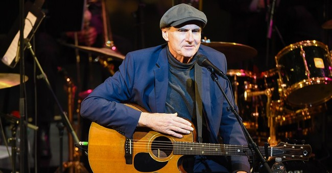 James Taylor, Paul Simon perform at benefit for jazz great