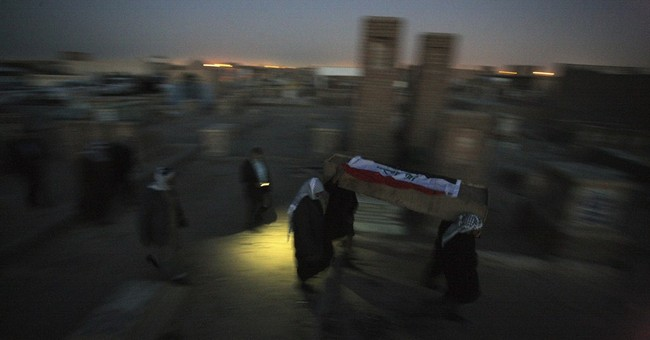 Officials say bombings kill 13 people in Iraq's capital