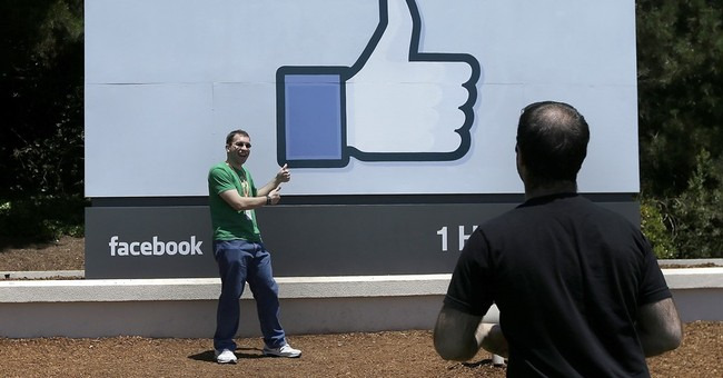Facebook 2Q results soar as user base, mobile ads grow